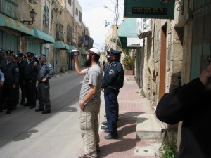 Watching him watching us: A Hebron settler films Shovrim Shtikah visitors to the city